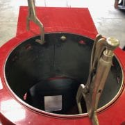 red Vertical Unload Auger tube liner with Cast elbow in a workshop