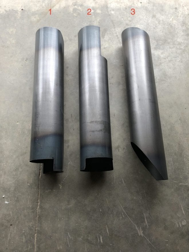 3 stainless steel Flagship, Mid-Range Bubble Ups laying on concrete