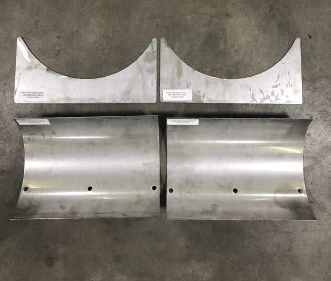 Metal Case IH sump kit liner on a concrete ground